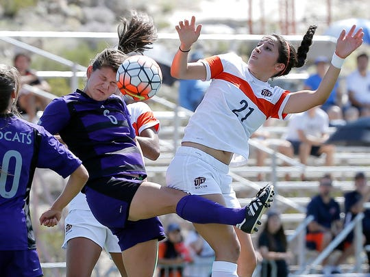UTEP's Bri Barreiro challenges Weber State's Marissa Cook for a header during a match at University Field.