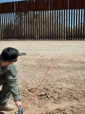 In this Thursday, April 14, 2016 photo provided by U.S. Customs and Border Protection, a Border Patrol agent shows the path of a tunnel that crosses the U.S.-Mexico border near Calexico, Calif. The passage extends about 60 feet into Mexico and at least 80 feet into the United States. It was not immediately clear if the tunnel was completed.(U.S. Customs and Border Protection via AP)