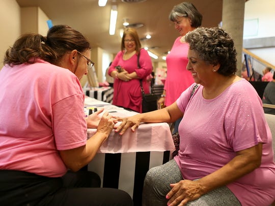 Supporter Maria Cruz (right) gets her nails painted pink by Karen Gray, community manager for The American Cancer Society, during the fourth annual Pink Party hosted in partnership with Shannon Medical Center and the San Angelo Museum of Fine Arts Thursday, Oct. 19, 2017.