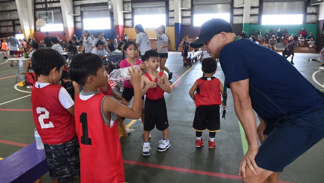 In this June 30 file photo, Raiders coach Eddie Ko talks with his players during a Guam Youth Basketball Association Drug Free League game at Astumbo Gym.
