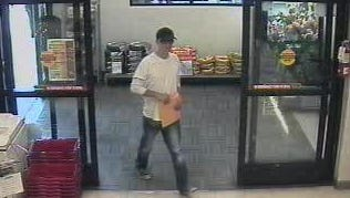 A man believed by Reno police to be involved in a Wells Fargo bank robbery on June 2, 2014, was captured in a photo by the Scolari's Food and Drug Store security camera.