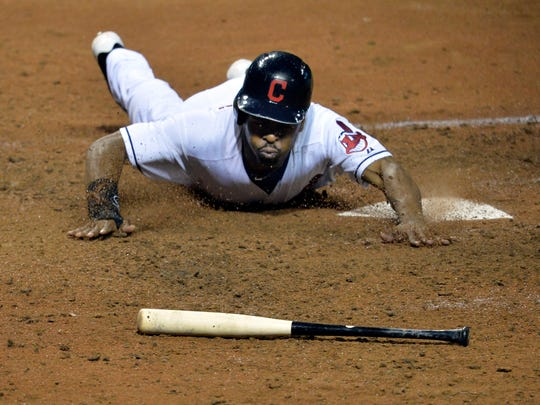 Cleveland Indians center fielder Michael Bourn (24) scores a run in the seventh inning against the Detroit Tigers at Progressive Field.