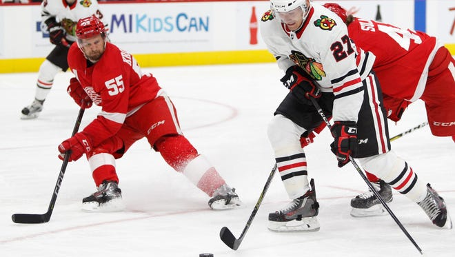 Niklas Kronwall, left, played in his 800th game on Friday despite suffering from a permanently damaged left knee.