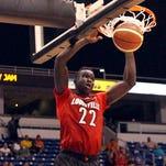 Louisville freshman Deng Adel slams in Tuesday's 94-88 loss to the Puerto Rico Junior National Team in San Juan.