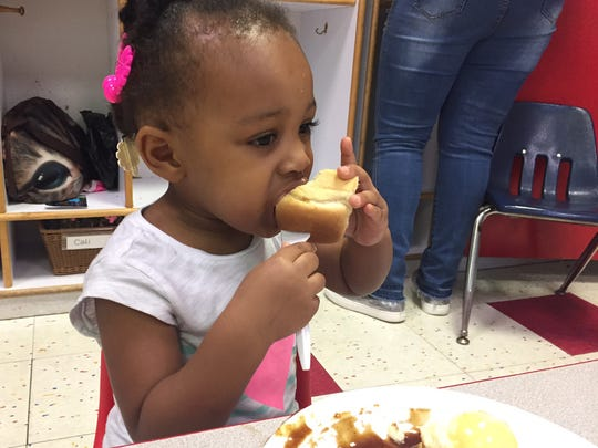 Riley, 2, eats lunch Friday morning at the Ministry of Caring's Child Care Center in Wilmington.