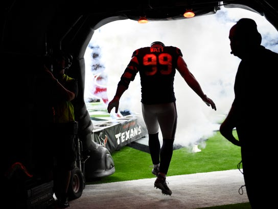 Houston Texans defensive end J.J. Watt (99) runs out of the tunnel as he is introduced before an NFL football preseason game against the New England Patriots Saturday, Aug. 19, 2017, in Houston. (AP Photo/Eric Christian Smith)