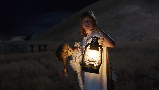 "Linda (Lulu Wilson) carries the Annabelle doll in ""Annabelle: Creation."""