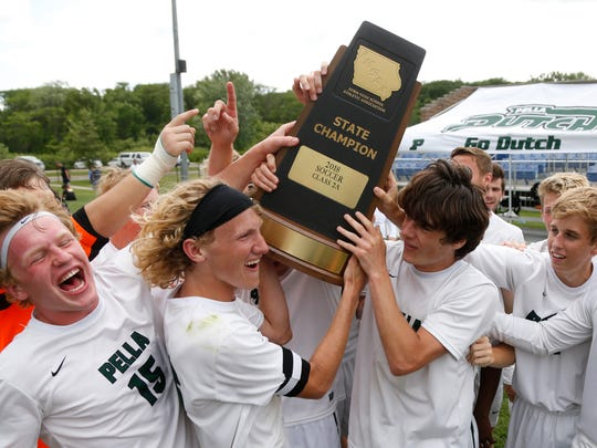 Pella players celebrate their 3-2 win over Storm Lake for the state title Saturday, June 2, 2018, following the 2A state soccer championship game in Des Moines.