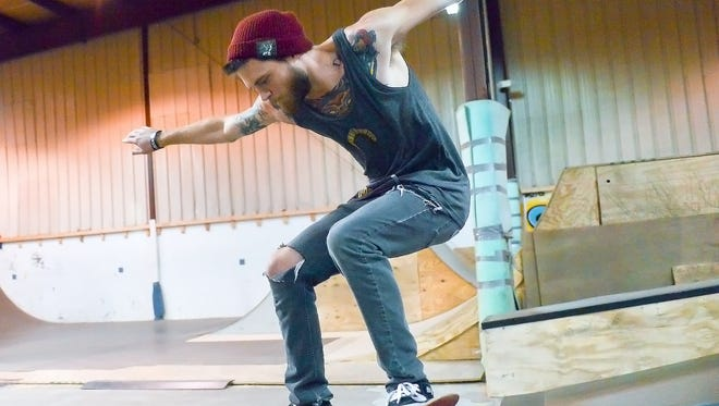 Trevor Heyd, Director of the Battleground skate park and pro skater for Wisdom Skateboards, hits the rail at Battleground skate park in February.