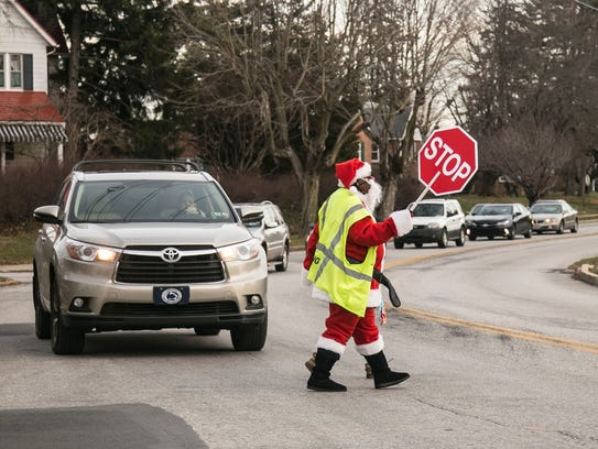 Dressed in her Santa Claus attire, Crossing guard Toyer