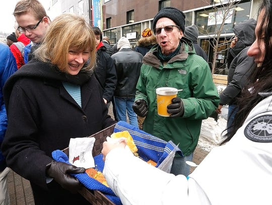 Volunteers sell cornbread to benefit the Fresh Snack