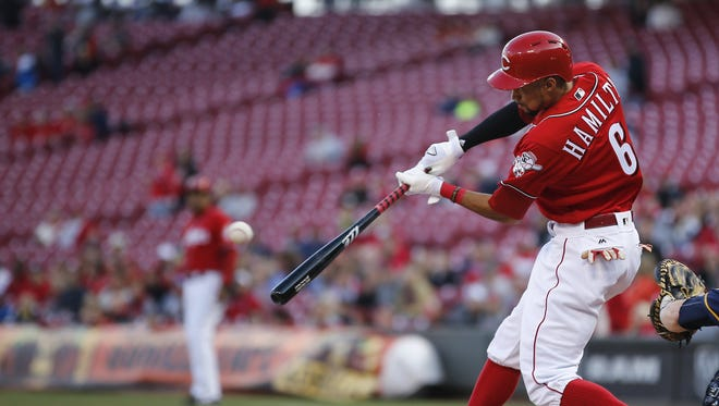 Reds center fielder Billy Hamilton doubles during a May 5 game against the Brewers.