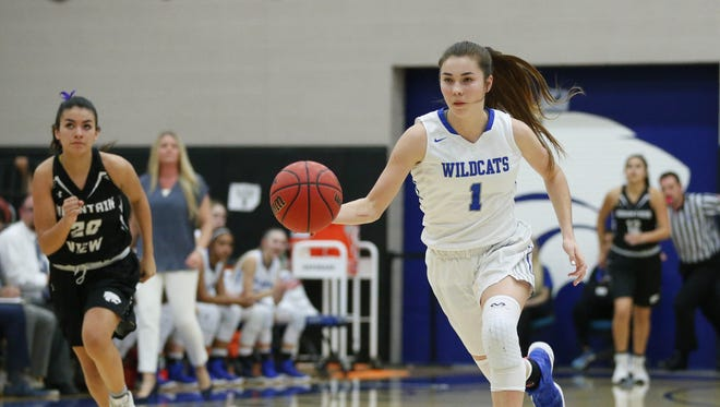 Mesquite guard Shaylee Gonzales (1) leads a fast break against Marana Mountain View during the first round of the 5a state conference tournament in Gilbert February 14, 2017. Mesquite won 93-31.