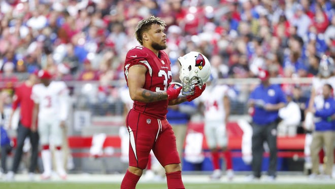 Arizona Cardinals free safety Tyrann Mathieu (32) removes his helmet during a break against the New York Giants during the second quarter at University of Phoenix Stadium in Glendale, Ariz. December 24, 2017.
