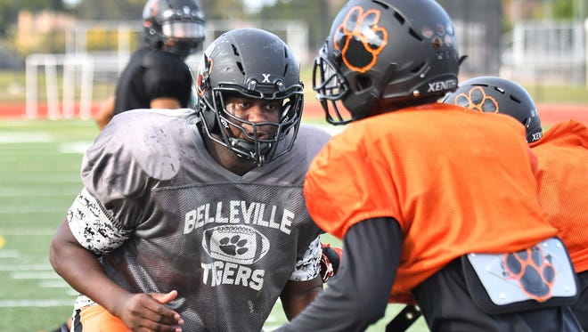 Belleville's Devontae Dobbs, left, is the top-ranked recruit in Michigan State's 2019 class.