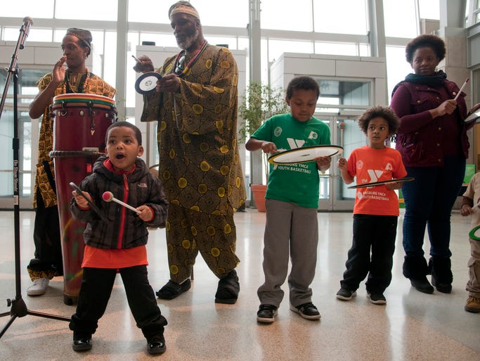"Children Tyrek Johnson, 3, Samuel Tandy, 8, and Arthur Rhea, Jr., 4, play drums with Mandela and Khabir Shareef during the annual Sankofa Black Heritage Festival at the Indiana State Museum, Saturday, Feb. 8, 2014. Sankofa, meaning ""reach back and fetch it,"" is a celebration of West African culture."