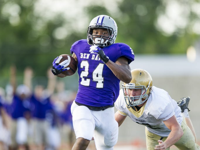 Ben Davis High School senior Dorian Tate (24) rushes into the end zone for a 52-yard touchdown run during the first half of action at Ben Davis High School, Friday, August 22, 2014. Ben Davis High School hosted Cathedral High School in varsity football action.