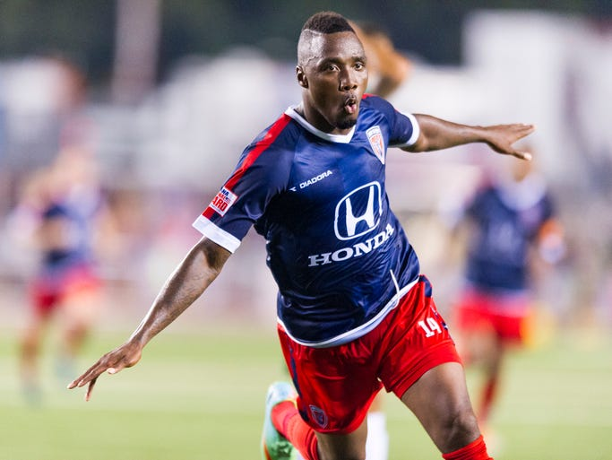 Indy Eleven'??s Jermaine Johnson (14) celebrates the game-tying goal during the extra time after the second half of action. Indy Eleven hosted New York Cosmos in NASL soccer action at Michael A. Carroll Track & Soccer Stadium in Indianapolis, Saturday, August 30, 2014. The game ended in a 2-2 tie.
