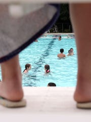 A lifeguard keeps watch as guests and campers swim at Germonds Pool in West Nyack was cited in 2012 for having improper chemicals in the water.
