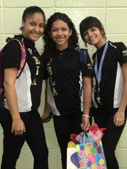 From left: Friends Deliana Gaetan, Kariangelys Rivera and Paola Ríos Rosario celebrate Kariangely's birthday at school in Toa Baja, Puerto Rico.
