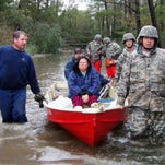 Virginia National Guard soldiers flood victims after Hurricane Sandy in October 2012. The state's governor has activated hundreds of guardsmen in anticipation of Hurricane Joaquin.
