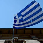 The Greek national flag is on display outside the Embassy of Greece to Germany on June 29, 2015 in Berlin. After talks between Athens and its creditors broke down, leaving Greece headed for an EU-IMF default and possible exit from the eurozone, the ECB said on June 28, 2015 it would keep open Emergency Liquidity Assistance (ELA) to the debt-hit country's banks.  AFP PHOTO / JOHN MACDOUGALLJOHN MACDOUGALL/AFP/Getty Images ORG XMIT: 5595 ORIG FILE ID: 542145833