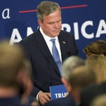 Jeb Bush reacts as he announces the suspension of his presidential campaign during an election night party at the Hilton Columbia Center on February 20, 2016.
