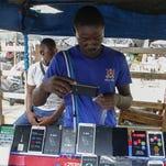 A money changer counts Nigerian naira currency at a bureau de change, in Lagos Nigeria.