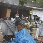 At least six Springfield Fire Department engines responded to a house fire on the 1100 block of West State Street July 22, 2016.