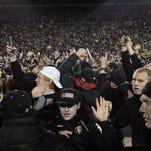 Colorado fans celebrate the win Buffaloes' win over Utah at Folsom Field.