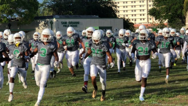 The Fort Myers football team takes the field before its spring game against Southwest Ranches Archbishop McCarthy on Friday.