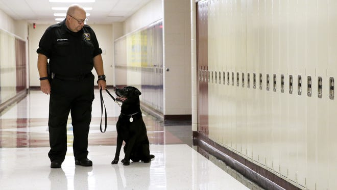 Pulaski police officer James Tinlin, who has served as a school liaison officer with the Pulaski Community School District for 25 years, and his K-9 partner, Raider, will retire from the department in August. The pair has worked together since 2009.