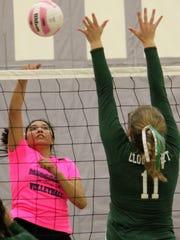 Mescalero's Katelyn Yuzos, left, hits a ball toward Cloudcroft's Diana Cook.