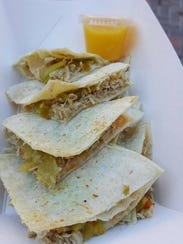 The Mini Pork Quesadillas with a side of the Mango Habanero Salsa at The New Mexican food truck.