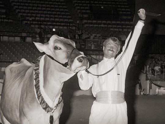 Steve Hendress of Wolcott, IN, reacts to his Brown Swiss Hoosier Knoll Jade Monay being named the 1994 Supreme Champion.