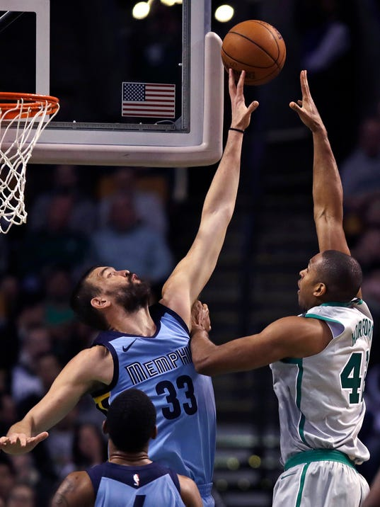Memphis Grizzlies center Marc Gasol (33) blocks a shot by Boston Celtics forward Al Horford, right, during the second half of an NBA basketball game in Boston, Monday, Feb. 26, 2018. (AP Photo/Charles Krupa)