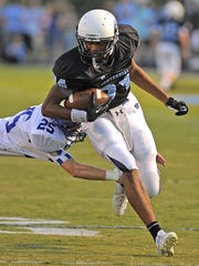 Emanuel Hall (84) pick up yardage during a 2013 contest.