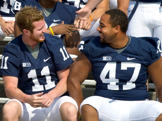 Penn State's Matt McGloin, left, and Jordan Hill joke before a team picture during 2012 Media Day. Both players, in addition to Michael Zordich, accepted invitations to play in All-Star games after the new year.