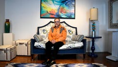 Michael Uvanni of Rome, N.Y., sits in one of his two