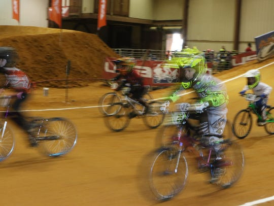 Competitors race in the BMX Cajun Nationals at the