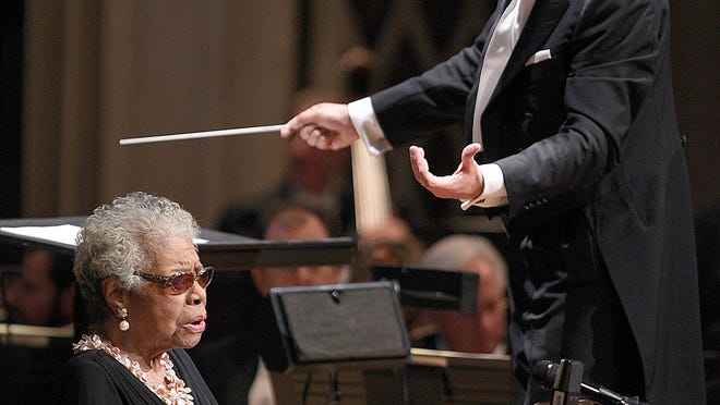 "Dr. Maya Angelou, left,  and Cincinnati Symphony Orchestra's 13th Music Director Louis Langr?ee, perform on November 8, 2013 at Music Hall in Cincinnati, Ohio. Dr. Angelou performed Copland's ""Lincoln Portrait"" with Langree during his debut concert."