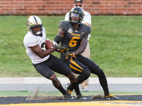 Purdue's Kamal Hardy, left, yanks the ball out of the hands of Missouri receiver J'Mon Moore, right, as he intercepted a pass in the end zone during the fourth quarter of an NCAA college football game Saturday, Sept. 16, 2017, in Columbia, Mo. Purdue won the game 35-3. (AP Photo/L.G. Patterson)