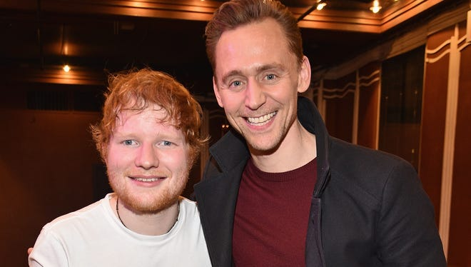 Cue the fan fiction: Ed Sheeran, left, and Tom Hiddleston at The Studio at Webster Hall in New York Monday.