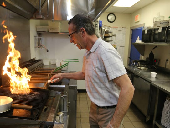 Jeffery Scott, general manager at Mom's Margios Diner in the Port of Rochester