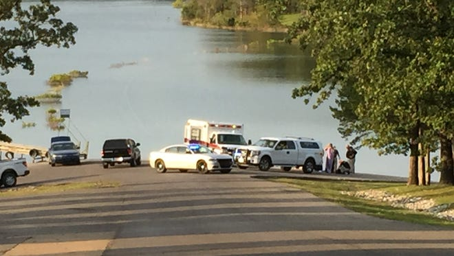 Emergency vehicles are seen at a boat launch area where authorities were investigating a drowning at Cranfield Park early Monday evening.
