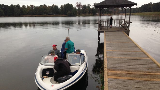 A group of outdoor writers head out on a trip around Caney Lake in Chatham.