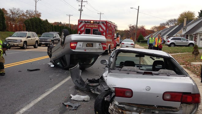 A 32-year-old woman was hospitalized following a crash near Elsmere Monday morning, New Castle County police said.