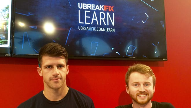 Justin Murphy, right, co-owns five uBreakiFix stores in Southwest Florida. He is joined by Matthew Ringland, managing partner of the Estero location.