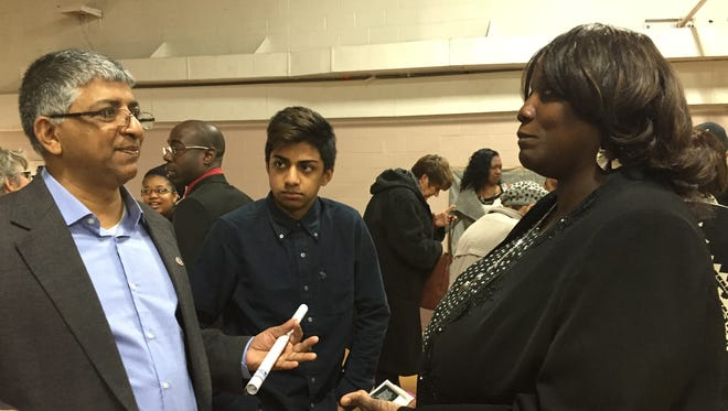 Clarissa Andrews, director of academic advising for the East Central and Richmond region of Ivy Tech Community College, exchanges ideas with Wazir Mohamed, associate professor of sociology at Indiana University East, after the 2015 Martin Luther King Jr. Breakfast Celebration. Listening is Mohamed's son, Aqib.