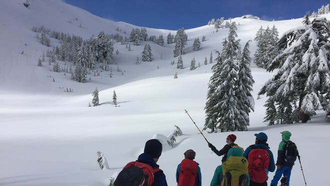 A group of backcountry skiers and snowboarders evaluate the avalanche risks in Lassen Volcanic National Park during a safety course in January, 2016.